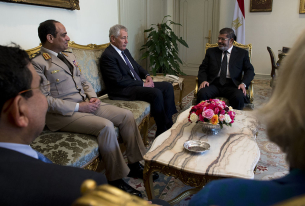 Morsi Attends Trial in a Glass Cage of Silence