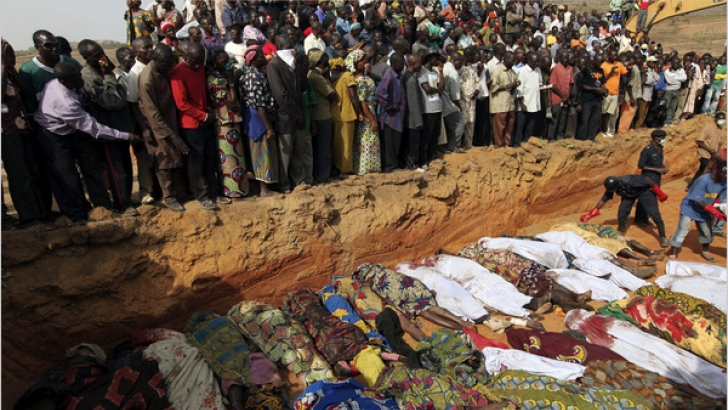 Mourners look on as thousands died in Baga Town after the most recent Boko Haram attack.