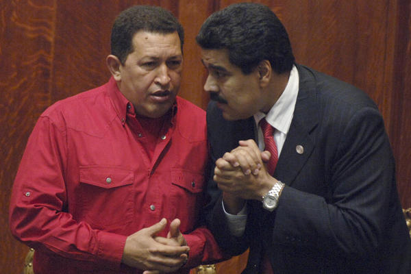 Nicolas Maduro (right) confers with the late Venezuelan President Hugo Chavez in 2007. Photo: Matilde Campodonico/AP/File