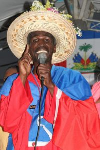 Harry Nicolas speaking at Kita Nago ceremony in Ouanaminthe