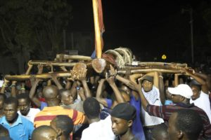 Kita Nago being carried by young haitians
