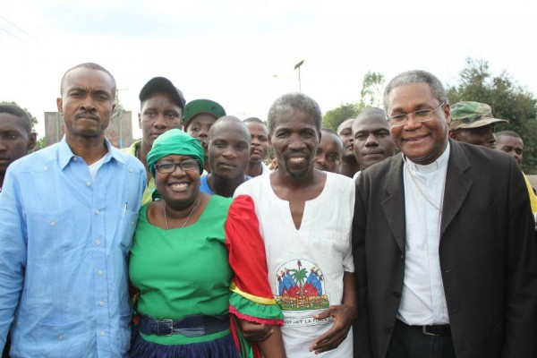 Harry Nicolas ( second from the right) posing with leaders in Ouanaminthe