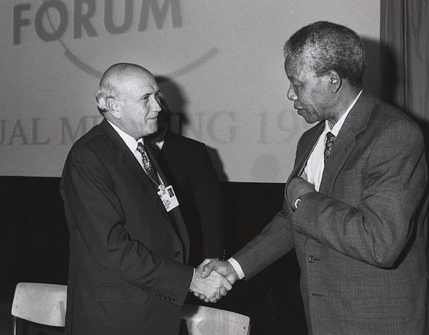 Frederik de Klerk and Nelson Mandela shake hands at the Annual Meeting of the World Economic Forum held in Davos in January 1992. Photo Credit: World Economic Forum