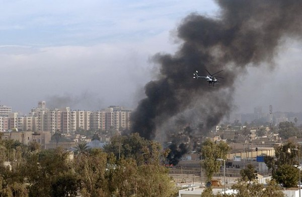 A Blackwater Security Company MD-530F helicopter aids in securing the site of a car bomb explosion in Baghdad, Iraq, on December 4, 2004, during Operation IRAQI FREEDOM.(U.S. Air Force Photo by Master Sgt. Michael E. Best) (Released) (Released to Public)