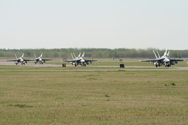 """CF-18s taxing (2785309768)"" by RAF-YYC from Calgary, Canada - CF-18's taxingUploaded by russavia. Licensed under CC BY-SA 2.0 via Wikimedia Commons"