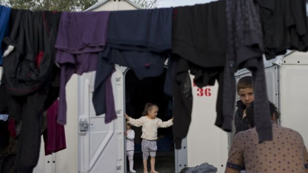 Children wait at a refugee camp on the island of Lesbos, Greece. Migrant arrivals in Greece have waned, though many are now held in Turkey after an EU agreement in March intended to control flow of migrants to the continent. Photo: AP via bbc.com