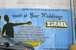 Gay Couples Courted for Middle East Stance with Mural