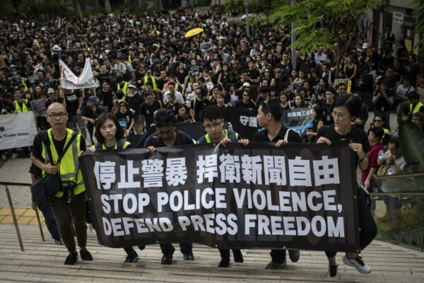 Protesters hold a banner during a march, organized by media groups and journalist trade unions, calling for press freedom amidst the ongoing protests in Hong Kong. In addition to political pressure, journalists have increasingly been the targets of physical and verbal assaults from police Ivan Abreu / SOPA Images/Sipa USA via The Associated Press