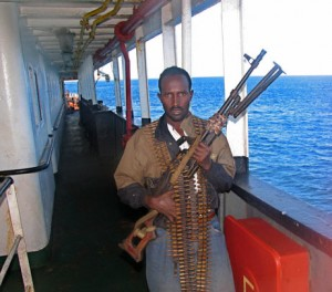 An armed Somali pirate (Photo: Abayomi Azikiwe via Flickr).