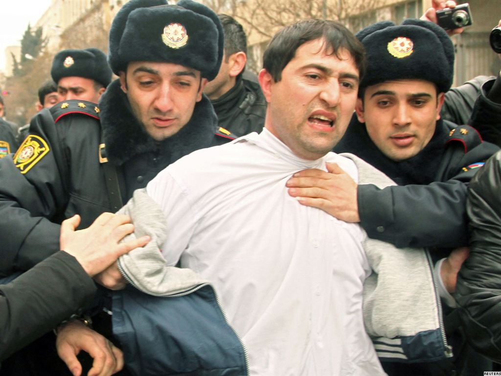 azerbaijan baku azeri rfe marked demand peoples police arrests turnout detain protester demonstrators beaten photographer change foreign reuters protest arrest