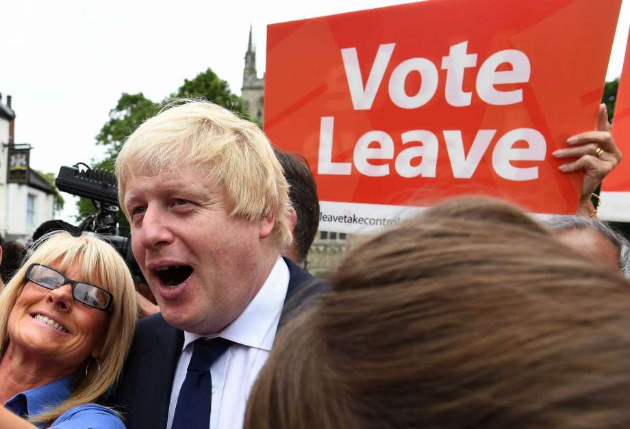 this Wednesday, June 22, 2016 file photo, advocate to exit Europe Boris Johnson poses for a selfie photo with voters during a whistle stop tour of the country on the final day of campaigning before Thursday's EU referendum vote, in Selby, north England. (Andrew Parsons / PA via AP, File)