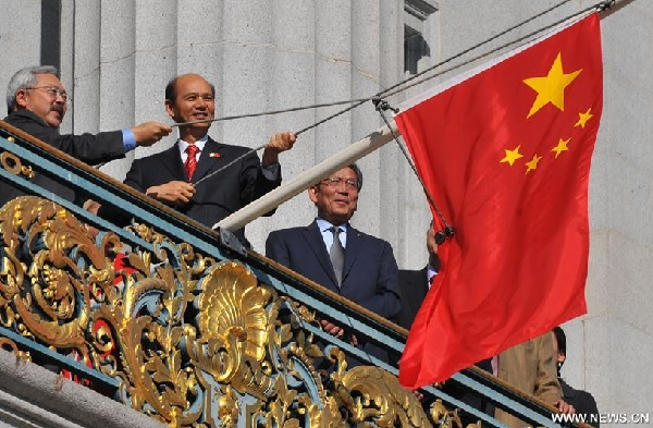 Mayor Ed Lee and PRC consul-general Luo Linquan raise the Chinese flag over San Francisco City Hall (Xinhua, Oct. 1)
