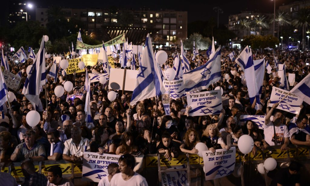 "Rally in favor of Elor Azaria in Tel Aviv. Signs read ""we love the IDF, free Elor"". (Flash90)"
