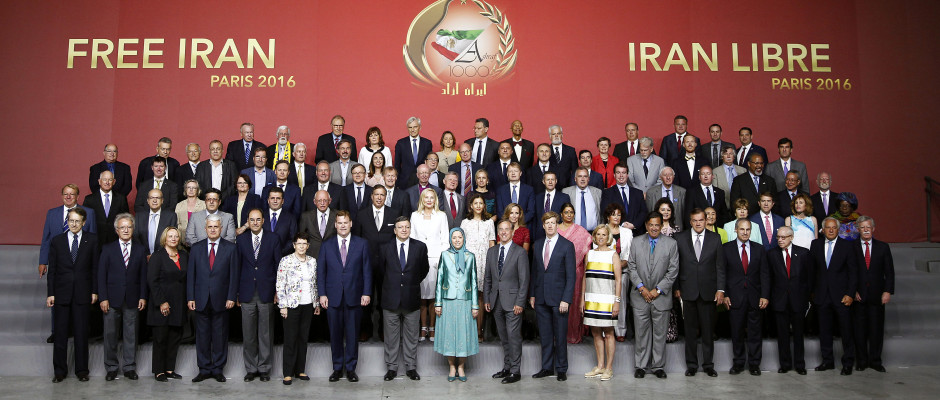 "International figures from the US, Europe, and the Middle East standing alongside Mrs. Maryam Rajavi, expressing their support for a ""Free Iran"" during the rally in Paris (Image source: https://themediaexpress.com/2016/07/15/french-arab-italian-and-european-delegations-among-others-pledge-support-at-iran-freedom-rally/)"