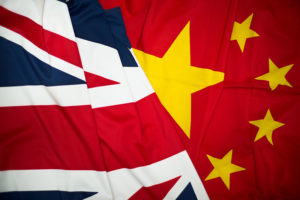 Chinese and UK flags merge together.