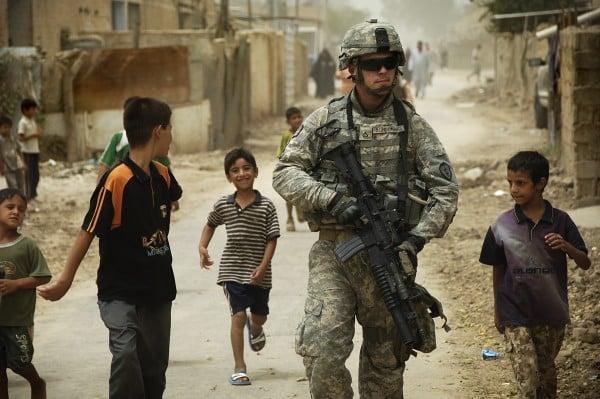 Iraqi children gather around as U.S. Army Pfc. Shane Bordonado patrols the streets of Al Asiriyah, Iraq, on Aug. 4, 2008. Bordonado is assigned to 2nd Squadron, 14th Cavalry Regiment, 25th Infantry Division. DoD photo by Spc. Daniel Herrera, U.S. Army. (Released)