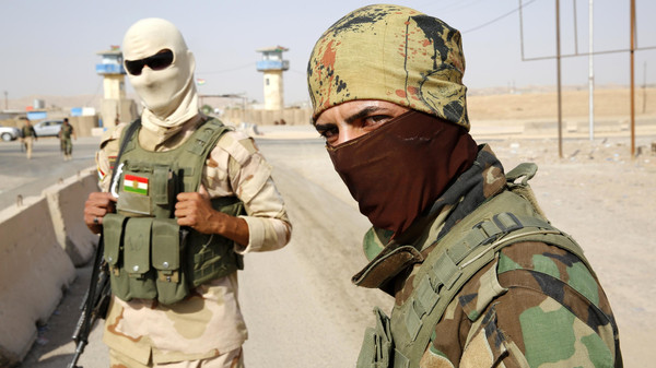 Members of the Peshmerga--Kurdish soldiers--guard a village in Iraq. Turkey is allowing Iraqi Kurds to pass its border with Syria to fight IS. But Turkish Kurds are not allowed, which may lead to more antagonism. Photo: Reuters via alarabiya.net