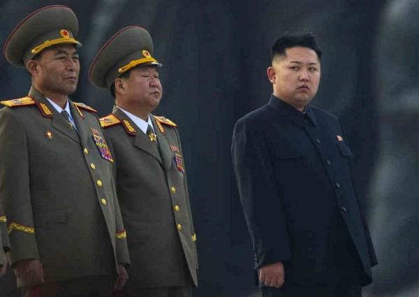 North Korean leader Kim Jong-un with two senior members of the military. Image: NPR