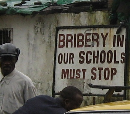 An anti-corruption campaign sign in Liberia. Photo by Geneva52, courtesy of Wikimedia Commons.