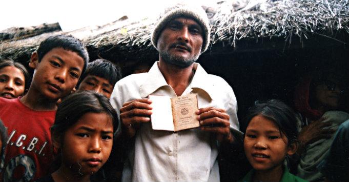 Bhutanese refugees in Beldangi I presenting a Bhutanese passport
