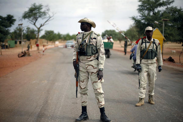 Malian soldiers guard a road that links the towns of Sevare and Gao in the country's northern region on Sun. Jan. 27, 2013. French and Malian forces have reversed militant rebel gains with a quick, powerful offensive over the last few days. Photo: Jerome Delay/AP