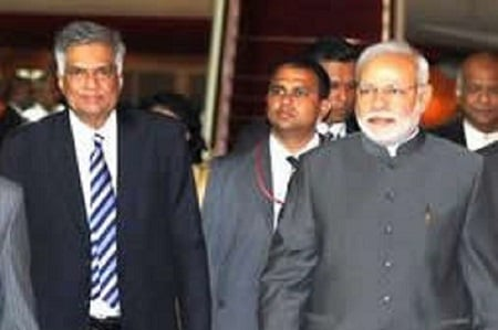 Prime Minister Narendra Modi being received at the airport by Sri Lankan Prime Minister Ranil Wickramasinghe, in Colombo on Friday. (The Hindu)