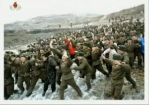 Picture shown on North Korean state television of North Korean soldiers rushing to greet Kim Jong-un. Image: The Guardian