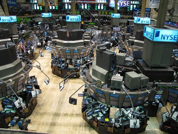 The majority of stock transactions now are executed virtually rather than on the trading floors of exchanges such as the New York Stock Exchange, above. Photo by Kevin Hutchinson via Wikimedia Commons.