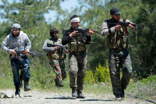 Rebel fighters from the Al-Ezz bin Abdul Salam Brigade Miguel Medina-AFP-Getty