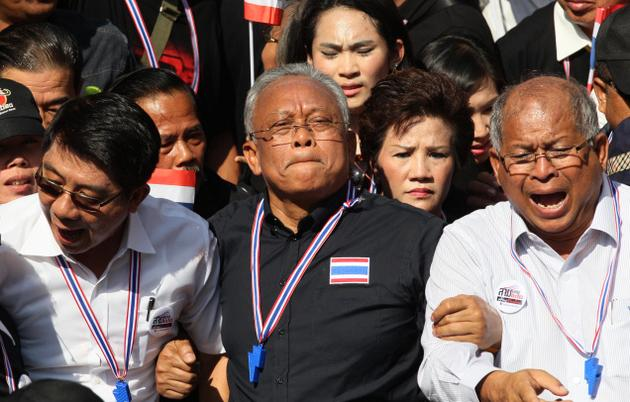 Thailand opposition leader Suthep Thaugsuban marches with supporters in Bangkok. Thousands of protesters took control of several government buildings on Nov. 25-27, 2013, forcing them to shut down. Photo: AP