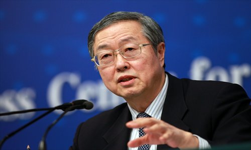 "The official Xinhua news agency's recent call for a ""de-Americanized world"" echoed the argument that Zhou Xiaochuan, above, Governor of the People's Bank of China, made in a 2009 paper urging adoption of a new international reserve currency that would replace the dollar as the primary medium of exchange in global commerce and finance."