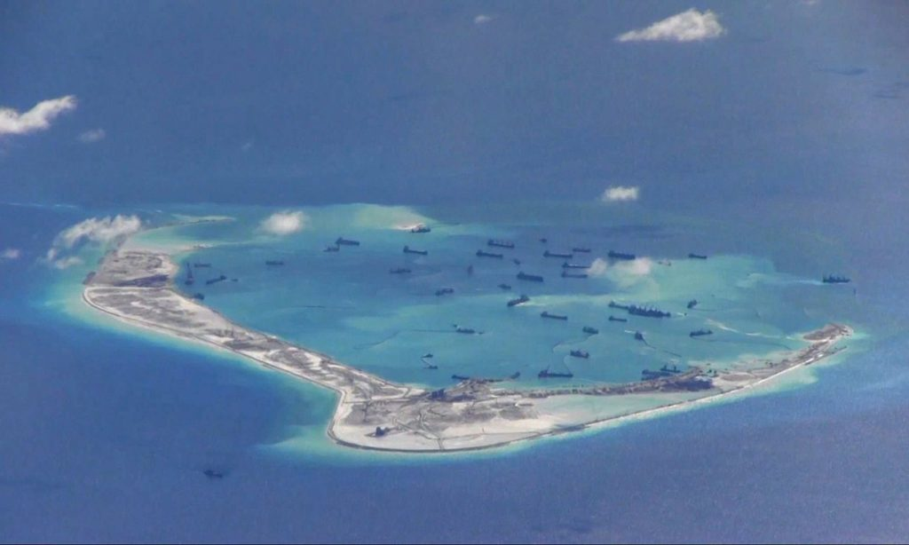 Image from a US Navy surveillance aircraft purportedly shows Chinese dredging vessels in the waters around Mischief reef in the disputed Spratly islands. (HANDOUT/Reuters)