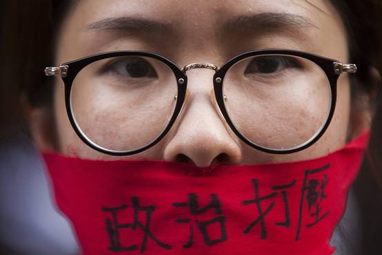 Face of a protester calling for greater freedom of speech marches through the streets of Hong Kong during the annual pro-Democracy rally on July 1, 2015. (European Pressphoto Agency)
