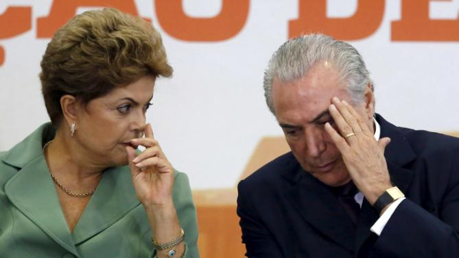 Brazil's President Dilma Rousseff (L) talks with Vice President Michel Temer during the launch ceremony of Brazil's 2015/2016 agriculture program, at the Planalto Palace in Brasilia, Brazil, June 2, 2015. Brazil's farm budget for the 2015/16 crop year will be more than 180 billion reais ($57 billion), according to a Tuesday presentation from the ministry of agriculture. An increase of at least 15 percent from last year's budget of 156 billion reais is a surprise, given that President Dilma Rousseff's government is cutting spending this year. Agriculture remains one of few bright spots in Brazil's economy. REUTERS/Bruno Domingos