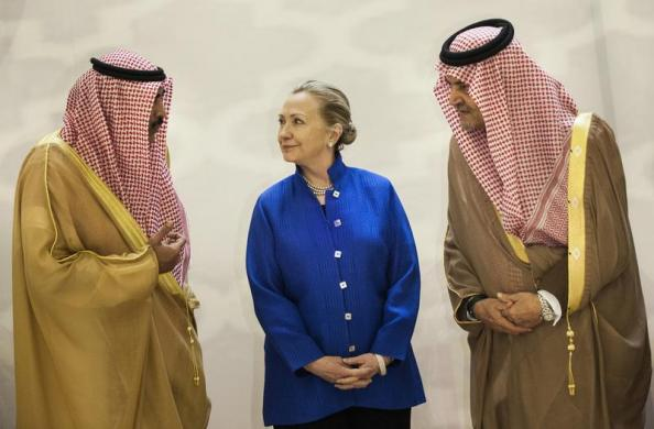 Saudi Arabia's Foreign Minister Saud al-Faisal, Secretary of State Hillary Clinton and Kuwait's Foreign Minister Sheikh Sabah Khalid Al-Hamad Al-Sabah chat prior to a group photo in March 2012. Photo Credit: REUTERS/Brendan Smialowski/Pool