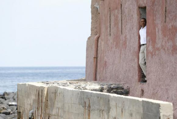 President Obama is pictured at the 'door of no return' as he visits the Maison Des Esclaves, the gathering point where African slaves were shipped west until the mid-19th century, at Goree Island near Dakar, Senegal, June 27, 2013. [REUTERS/Jason Reed]