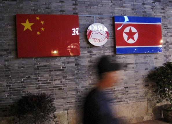Flags of China and North Korea are seen outside the closed Ryugyong Korean Restaurant in Ningbo, Zhejiang province, China, in this April 12, 2016 file photo. REUTERS/Joseph Campbell/Files