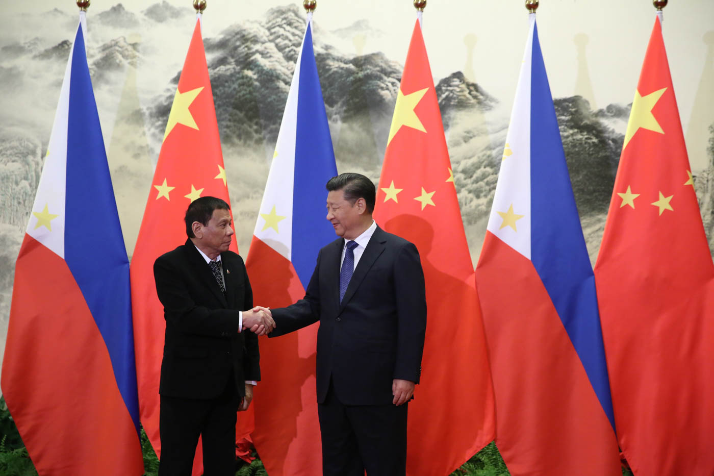 President Rodrigo Duterte and People's Republic of China President Xi Jinping shake hands prior to their bilateral meetings at the Great Hall of the People in Beijing on October 20. (King Rodriguez/PPD)