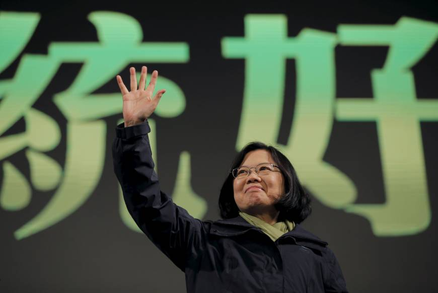 Tsai Ing-wen waves to supporters at her party's headquarters in Taipei on Saturday after her victory in Taiwan's presidential election.