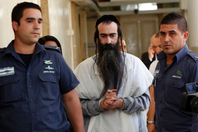 Israeli ultra-orthodox Yishai Shlissel (C), accused of stabbing six people at Pride Parade.