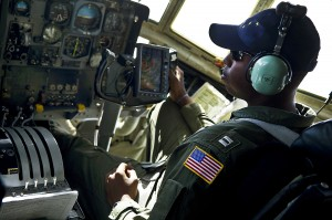 U.S. Coast Guard Lt. Randall Black pilots a helicopter over the Bering Sea to Barrow.