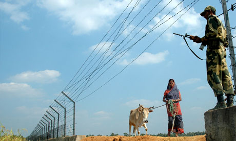 Indian solider guards the new border fence with Bangladesh
