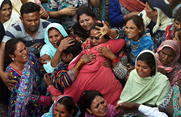 Pakistanis mourn as they attend a funeral for a blast victim of the March 27 suicide bombing, in Lahore (ARIF ALI/AFP/Getty Images)