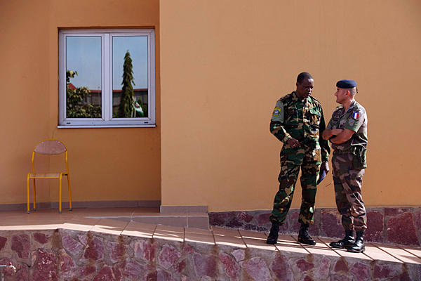 French and a Malian Army officer confer in Mali's capital city of Bamako on Jan. 15, 2013. France has sent military forces to support its former colony Mali in combating rebel forces. Photo credit: Joe Penney/Reuters