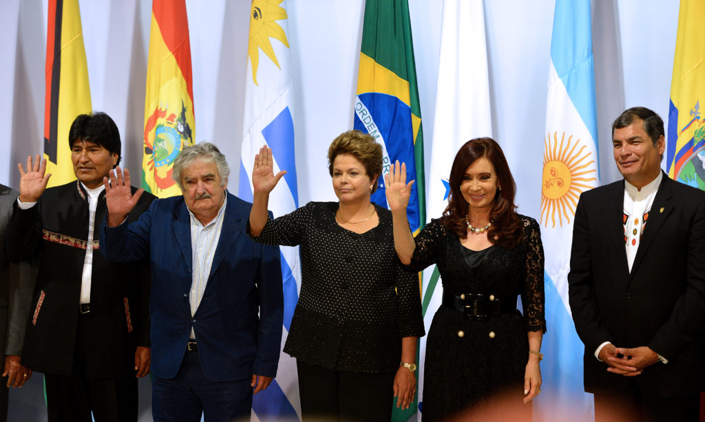 (L to R) Presidents from Bolivia, Evo Morales, Uruguay, Jose Mujica, Brazil, Dilma Rousseff, Argentinian Cristina Fernandez de Kirchner and Ecuador, Rafael Correa, pose for the official picture of the Summit of Heads of State of Mercosur and Associated States, at Itamaraty Palace, Brasília on December 7, 2012. AFP PHOTO/Pedro LADEIRA (Photo credit should read PEDRO LADEIRA/AFP/Getty Images)