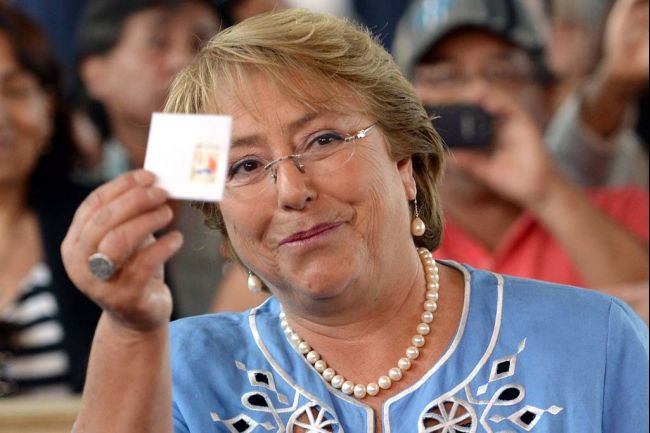 Michelle Bachelet, candidate for president of Chile, casts her vote in Santiago on Dec. 15, 2013. In an election featuring 2 female contenders, Bachelet emerged victorious and will take office for a second time early next year. Photo credit: Martin Bernetti AFP/Getty Images via globalpost.com