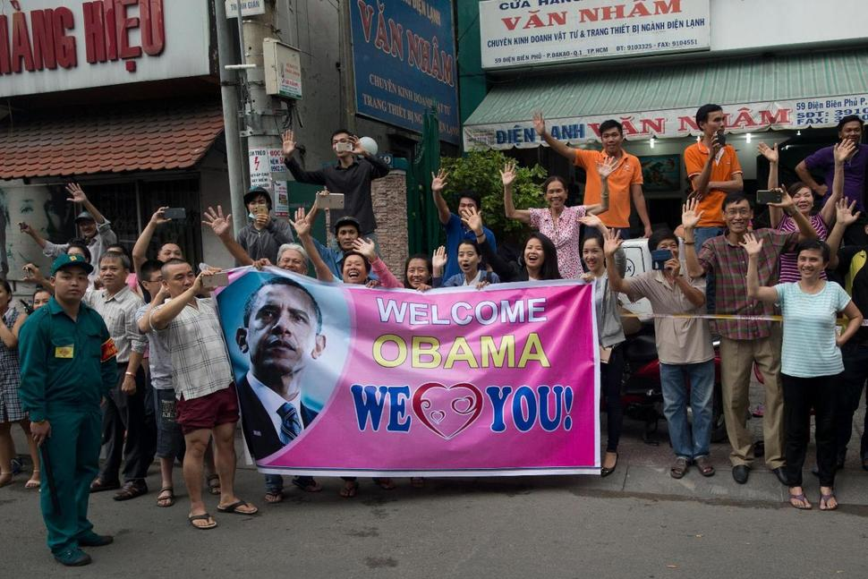 Crowds show support for visiting U.S. President Barack Obama in Ho Chi Minh City, Vietnam on May 24, 2016. While Obama spoke of the need for Vietnam to improve its human rights record, lifting of an arms embargo showed there are other considerations in play. Photo credit: AP/Carolyn Kaster via usnews.com