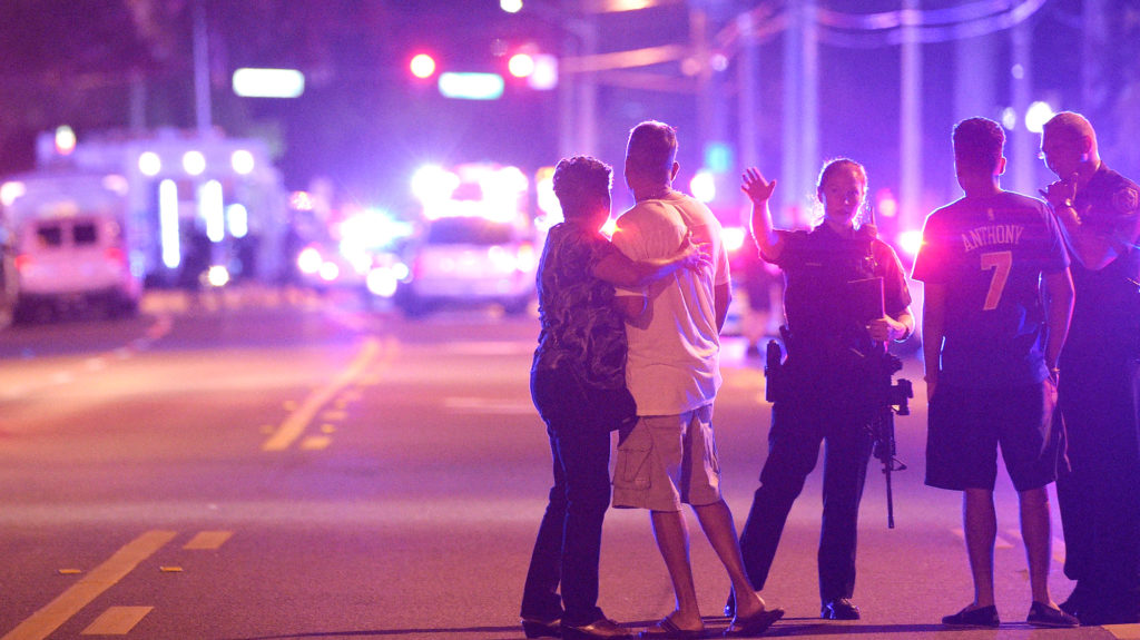 Police officers direct family members away from the attack at Pulse early Sunday morning. (AP/Phelan M. Ebenhack)