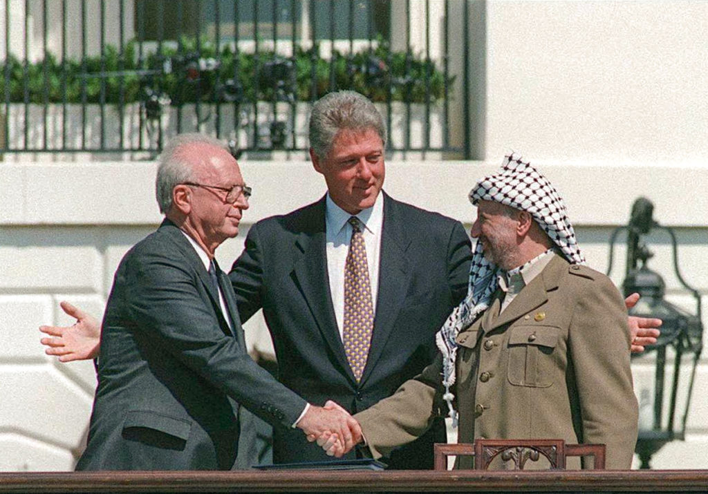 "Photo by  /GPO/Israel Sun 13-09-1993PLEASE CREDIT /GPO ONLYWe're coming up on the 20th anniversary of the Oslo AccordsYitzhak Rabin, Bill Clinton, and Yasser Arafat at the Oslo Accords signing ceremony on 13 September 1993 at the White Houseטקס הסכם אוסלו בבית הלבן וושינגטון ארה""ביאסר עראפת לוחץ את ידו של רה""מ יצחק רבין במרכז נשיא ארה""ב ביל קלינטוןצלום ל.ע.מ.     More details Yitzhak Rabin, Bill Clinton, and Yasser Arafat at the Oslo Accords signing ceremony on 13 September 1993"