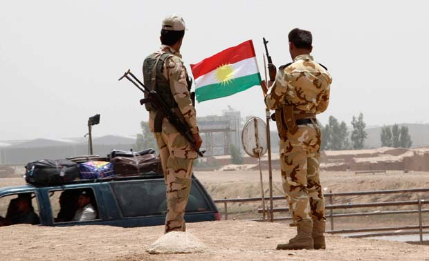 Soldiers of the Kurdish military (peshmerga) stand guard on the outskirts of Kirkuk in June 2014. The current status of peshmerga forces controlled by different political parties is a major obstacle to a stable Kurdistan. Photo credit: REUTERS/Ako Rasheed